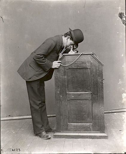 Publicity photograph of man using Edison Kinetophone, 1895